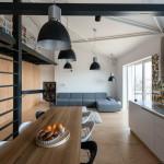 Loft lakás a tetőtérben nappali konyha és galéria, könyvtár